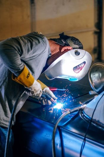 welding professional working on a car