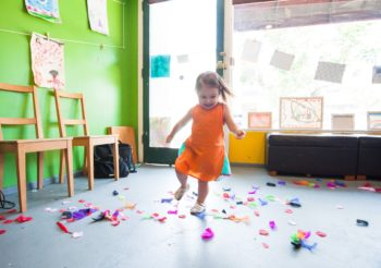 a young preschooler dancing at school