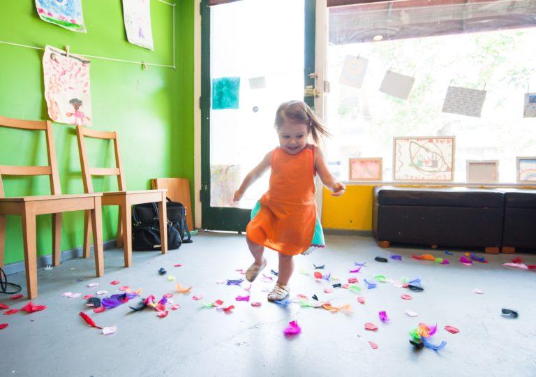 a young preschooler dancing at school