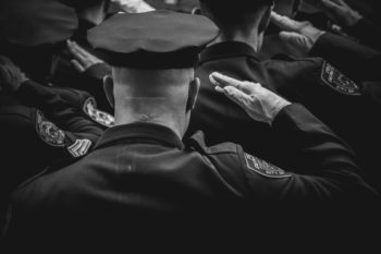 a group of police officers saluting their captain
