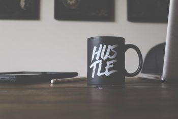 a coffee cup that says hustle