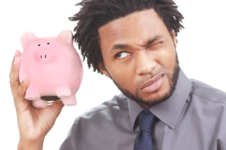a man holding his piggy bank