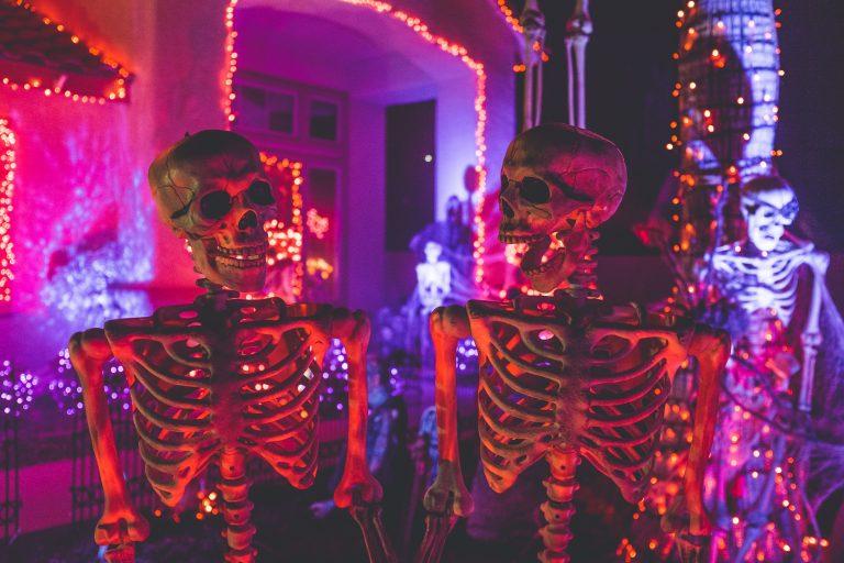 two skeleton decorations on halloween